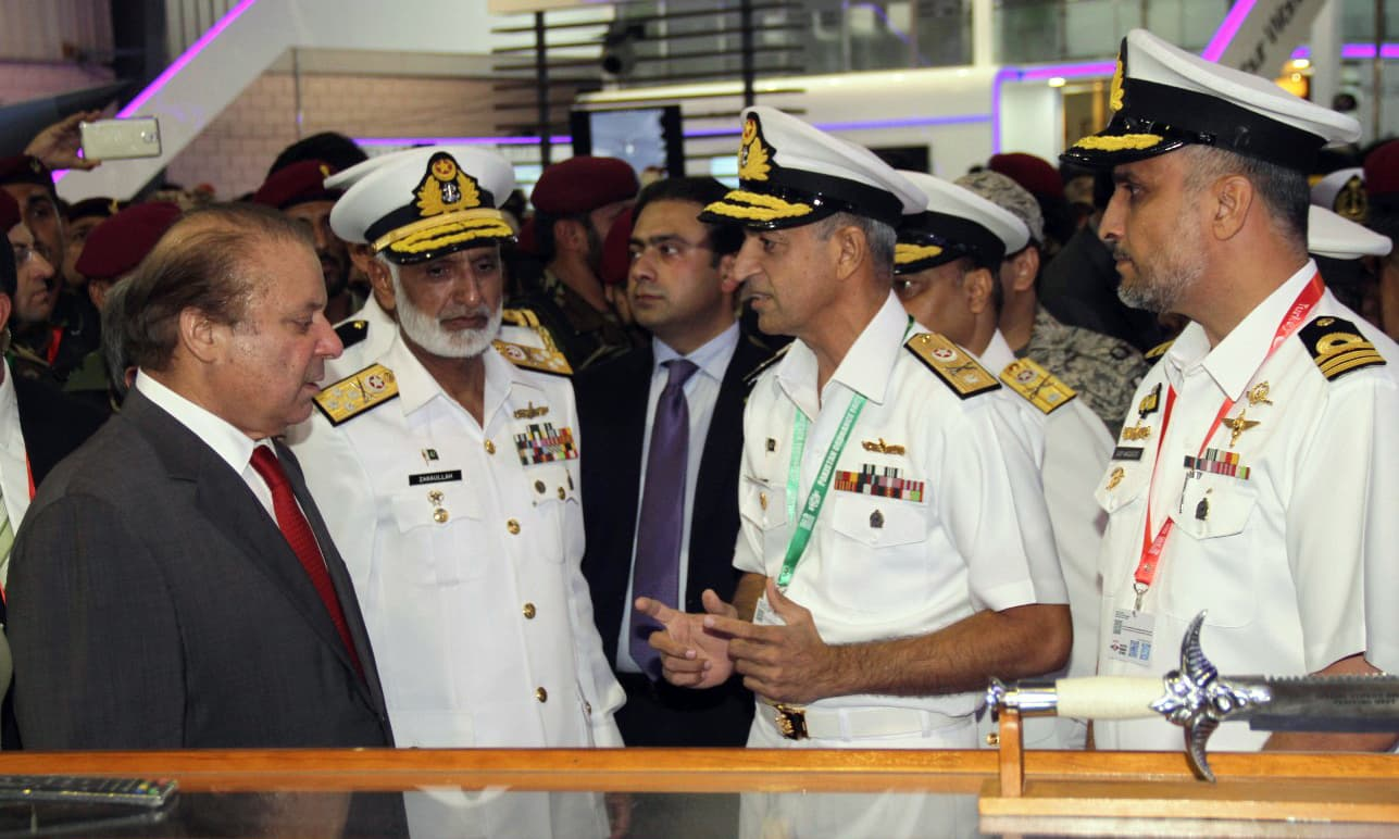 PM Nawaz and the navy's chief being briefed at the stall of Pakistan Navy during IDEAS 2016. –Navy PR
