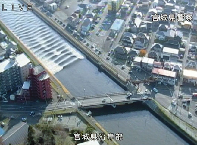 Tagajo (Japan): A tidal surge in Sunaoshi River after tsunami advisories were issued following the earthquake.—Reuters