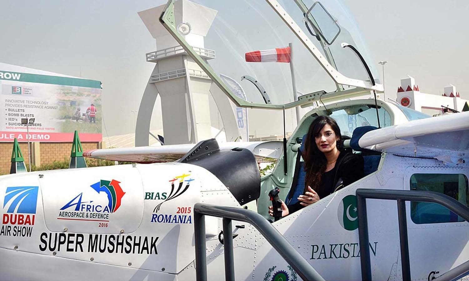 A woman sitting in the cockpit of Super Mushshak aircraft.─APP