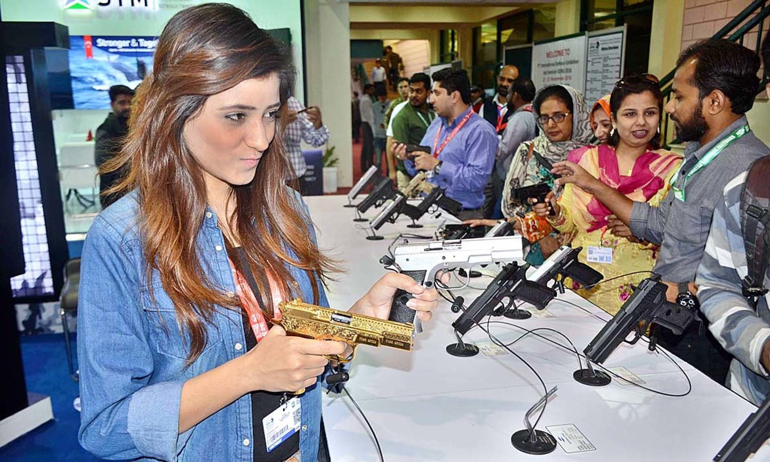 Visitors taking keen interest in weapons displayed on stalls during 2nd day of IDEAS-2016. ─APP