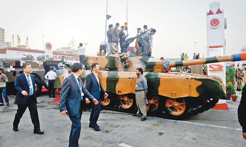 FOREIGN delegates gather around the Al-Khalid tank on Wednesday.—Fahim Siddiqi / White Star