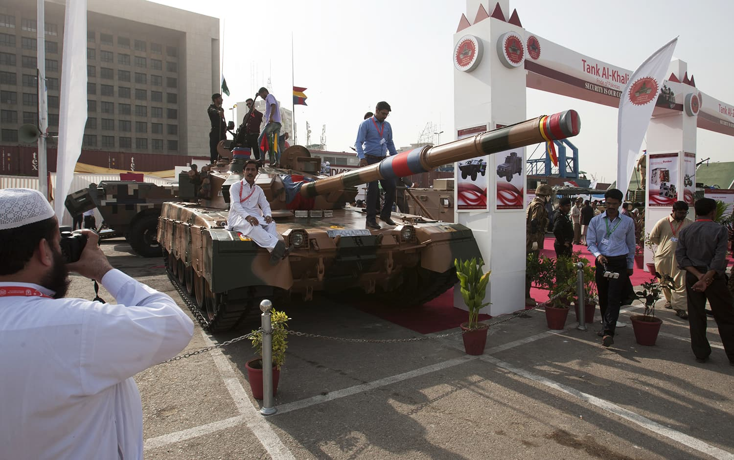 Visitors look at Pakistan made tank Al-Khalid display at the four-day IDEAS-2016. -AP