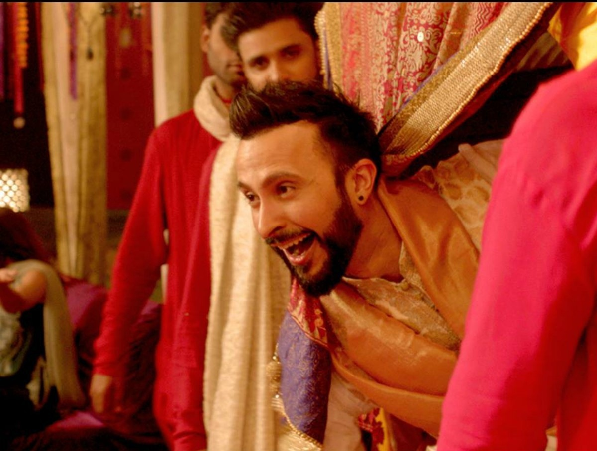 Ali Kazmi as Vasay blows kisses to his mehendi guests as he enters in a bridal doli