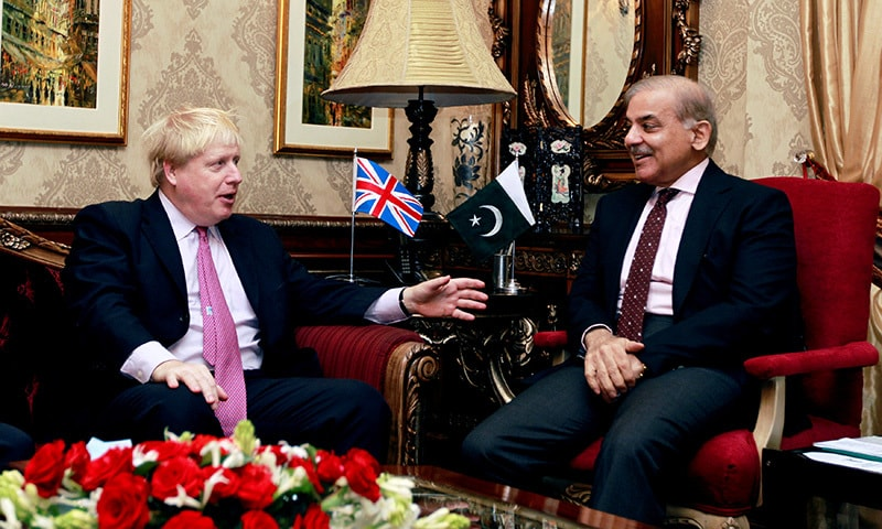 Britain's Foreign Secretary Boris Johnson meets with Punjab Chief Minister Shehbaz Sharif at his home in Lahore.— Reuters