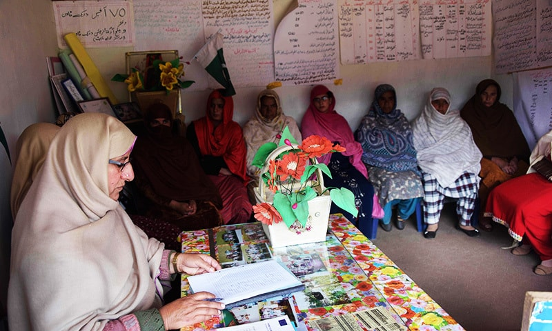 Kashmiri social worker Nusrat Yousuf (L) listens to the social issues of women at her office in the women's market—AFP