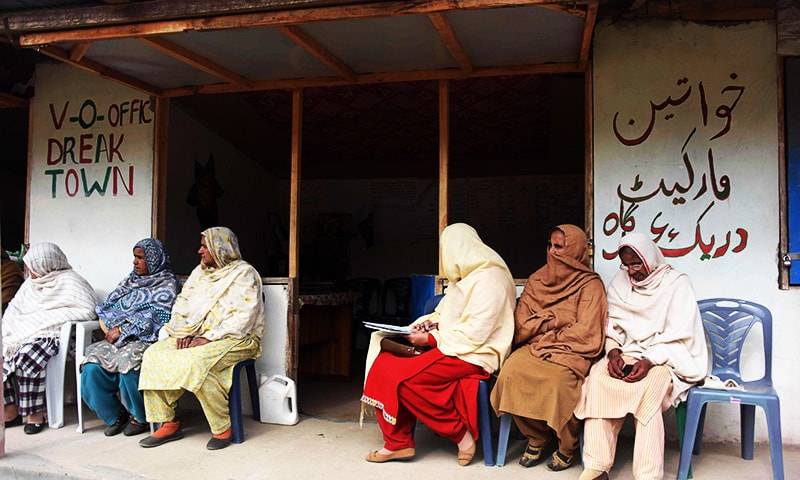 Kashmiri women wait outside the office of social worker Nusrat Yousuf to discuss their social issues with her in the women's market.—AFP