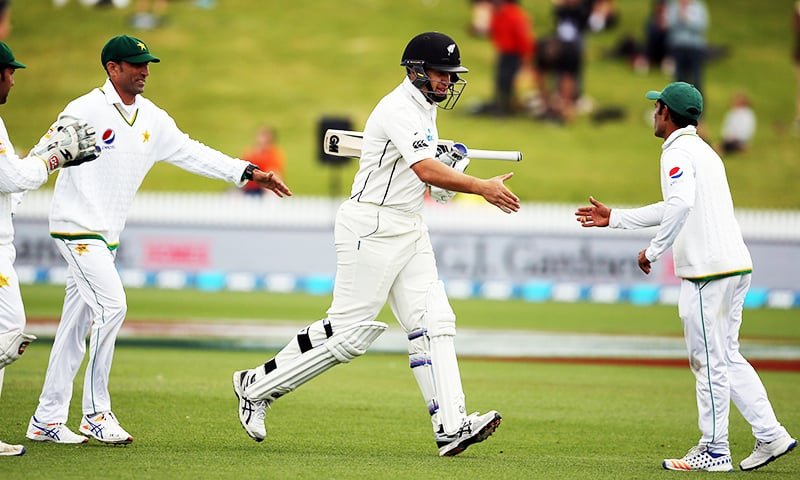New Zealand's Ross Taylor (C) celebrates his century as New Zealand declear during day four of the second cricket Test match between New Zealand and Pakistan at Seddon Park in Hamilton. — AFP