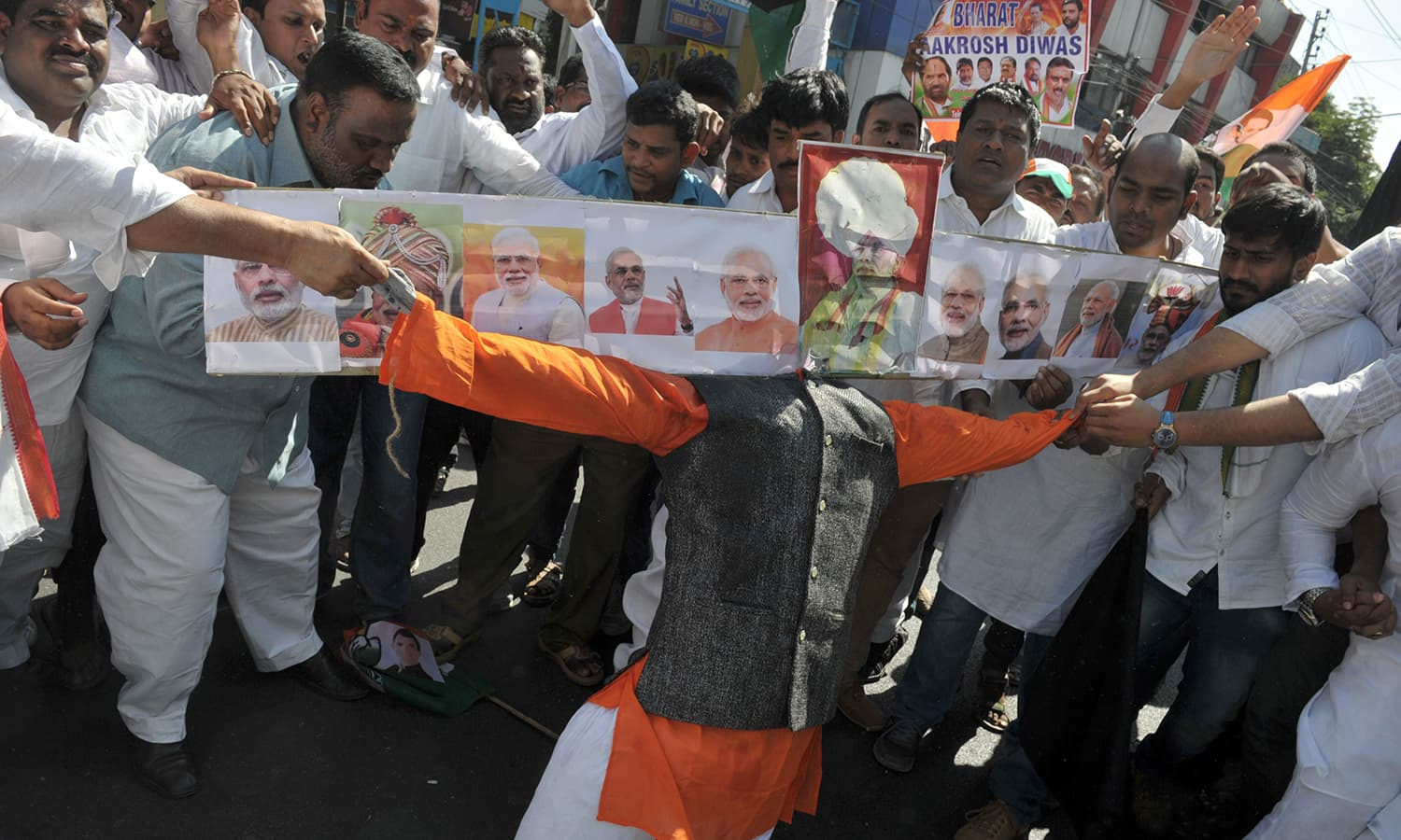 Members of the Congress party hold an effigy representing Indian Prime Minister Narendra Modi during a protest as part of 'Jan Aakrosh Diwas' in Hyderabad. ─AFP