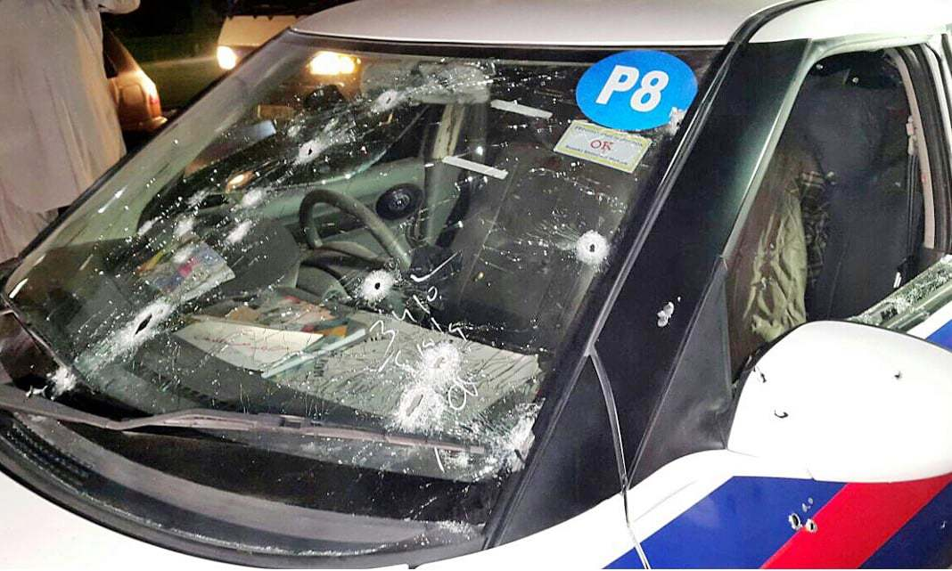 A view of bullet holes on windscreen of a police vehicle which was attacked by unidentified gunmen. ─Online