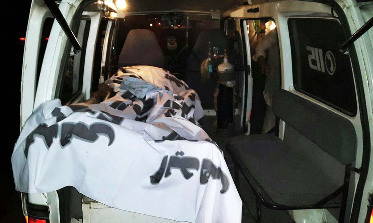 Body of a policeman seen in an ambulance. ─Online