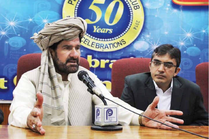 Malik Shahzad Khan, a tribesman from North Waziristan, addresses a press conference in Peshawar on Monday. — Online