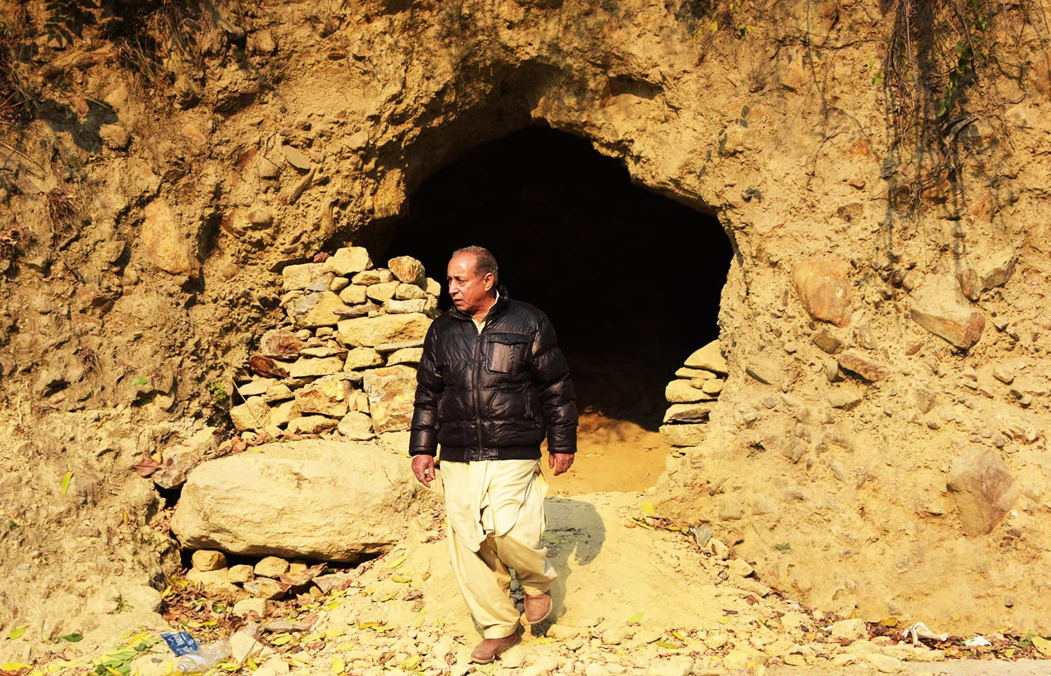 A man walks out of  a bunker in Athmuqam village at the LoC.—AFP