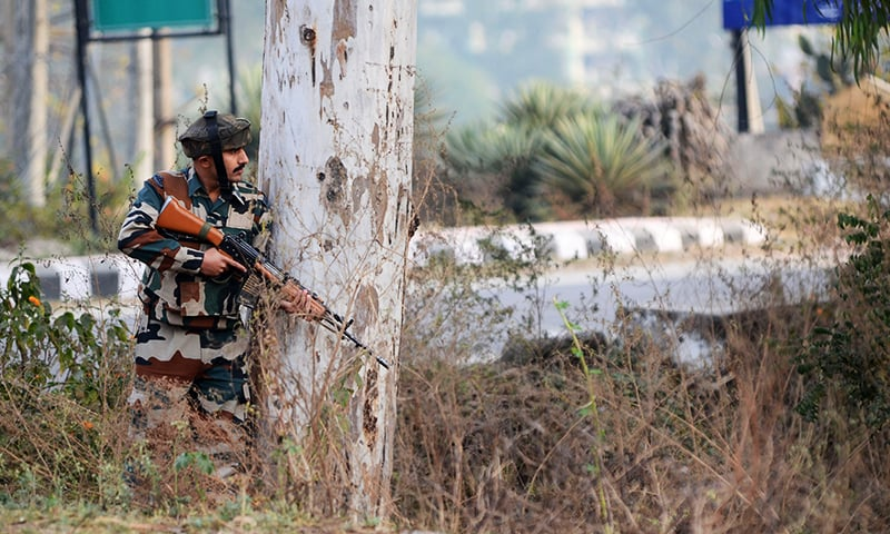An Indian army soldier stands guard during a gun battle with armed militants at an Indian army base at Nagrota. -AFP