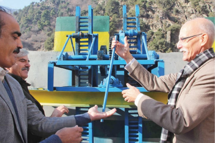 European Union Ambassador Jean Francois Cautain inaugurates the hydro power station in Kalam valley on Wednesday. — Dawn