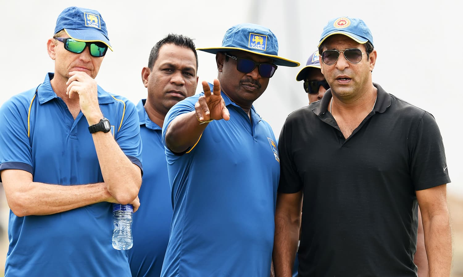 Sri Lanka's cricket coach Graham Ford and bowling coach Champaka Ramanayake speak with Wasim Akram during his first coaching session. -AFP