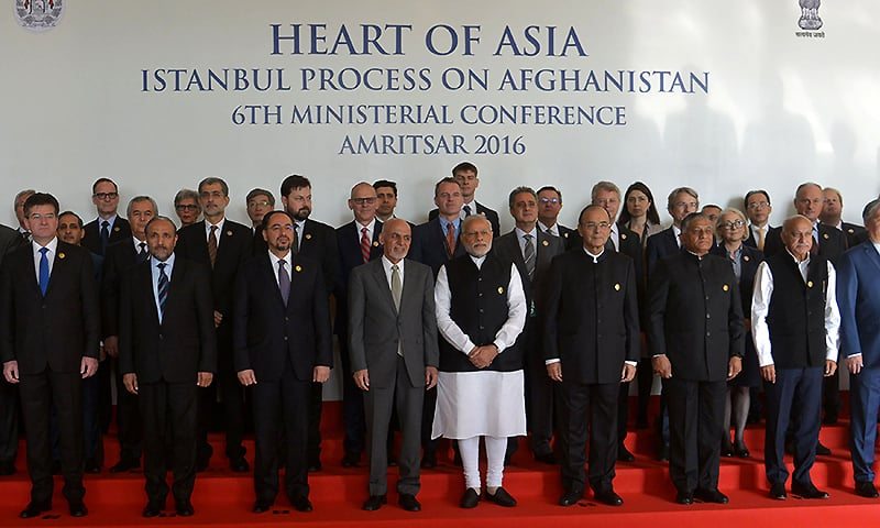 Attendees pose for a photograph at the conference. ─ AFP