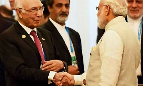 Sartaj Aziz and Indian PM Narendra Modi shake hands upon the former's arrival in India. ─ Photo courtesy Radio Pakistan