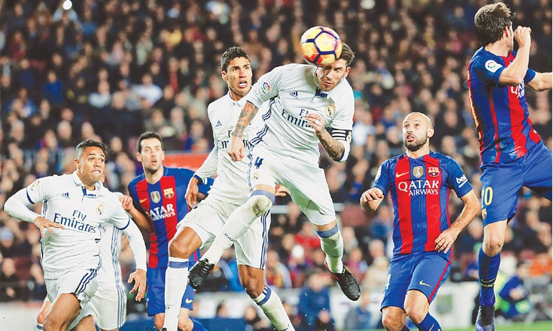REAL Madrid's Sergio Ramos leaps high to head the equaliser and secure a 1-1 draw against Barcelona.—AFP