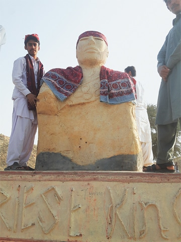 THE statue symbolising an artefact, the 'Priest King', belonging to the 5,000-year-old Indus civilisation is decorated with Sindhi cap and Ajrak at Moenjodaro.—Dawn