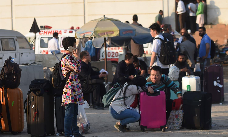 Guests gather outside Regent Plaza. — AFP