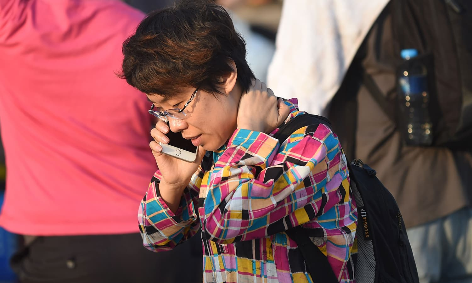 A guest talks on her mobile phone outside the hotel. — AFP
