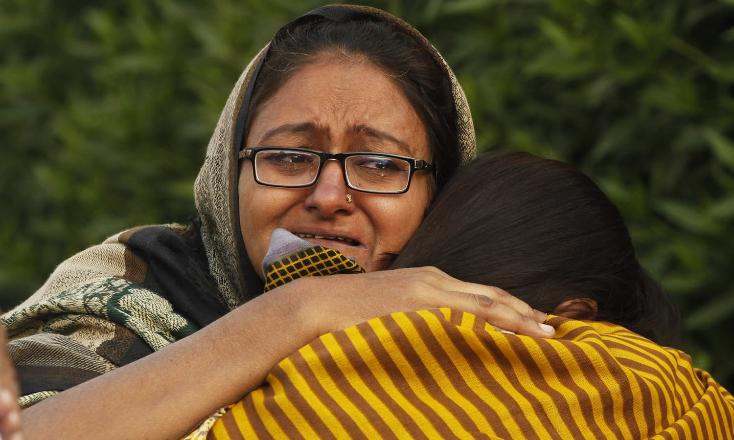 People mourn the death of their family member following the fire.— AP