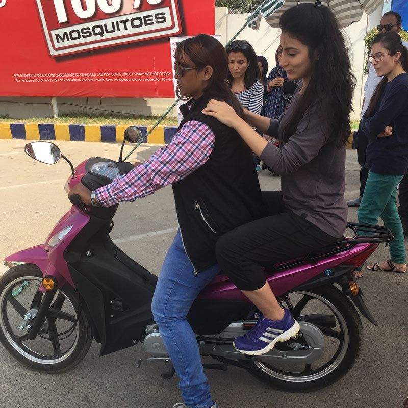 I hopped on the hot pink Scooty behind Mehwish as she taught me the basics. We definitely share a connection.