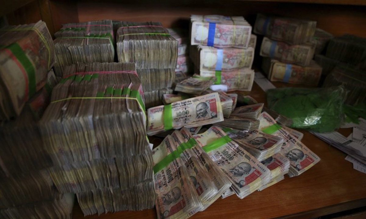 Discontinued Indian currency notes of 1,000 denomination that have been deposited at a bank in Bangalore, India | AP