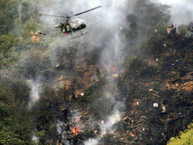 Helicopters circle overhead the crash site. ─ Local police