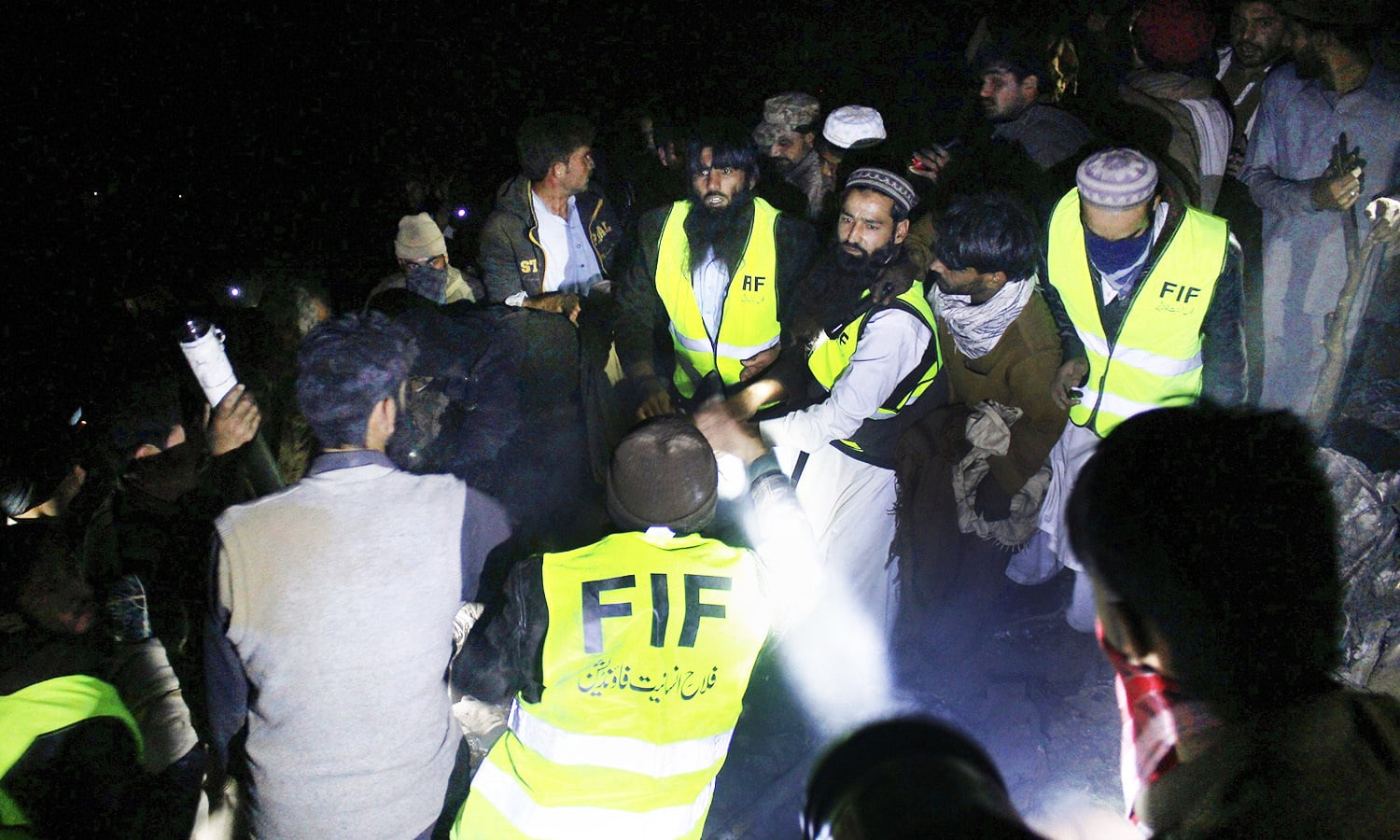 Pakistan Army troops and rescue workers collect remains of victims at the site of the plane crash. -AFP