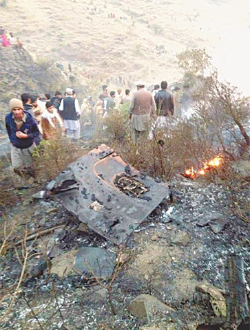 Wreckage of PIA flight PK-661 lies near Havelian after it crashed while on way to Islamabad from Chitral on Wednesday evening.—INP
