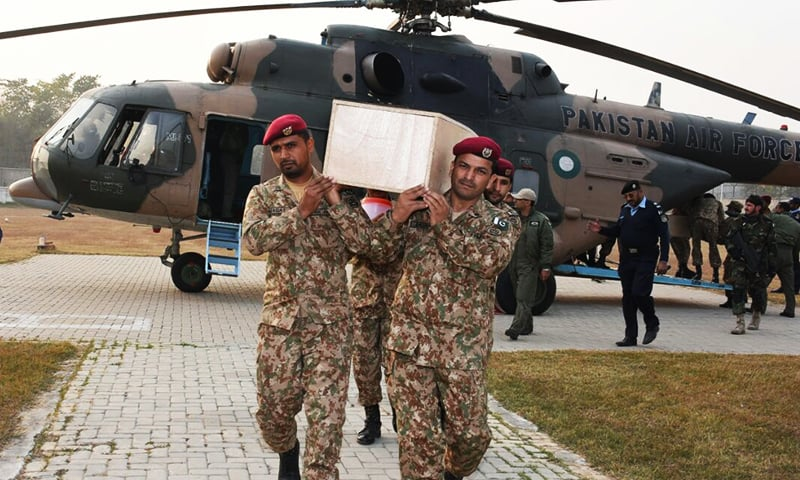 Army men transporting remains of air crash victims. ─ Photo courtesy ISPR