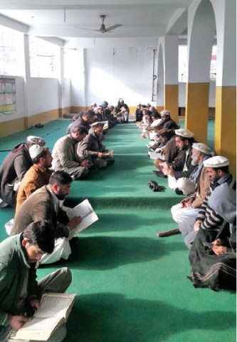 Quran Khawani for air crash victims being held at a mosque in Chitral. —Dawn