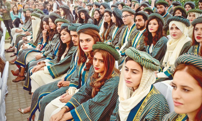 The graduating students listen to speeches at the convocation.—White Star