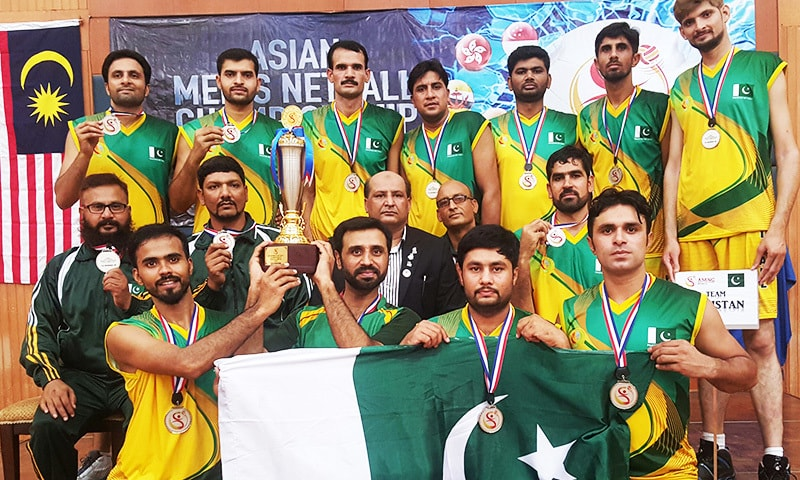 Pakistan's netball taem with their runner-up trophy and medals. — Pakistan Netball Federation