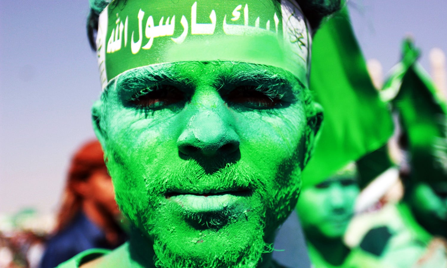 A Muslim Yemeni shows of his coloured face during a gathering marking the birth anniversary of Islam's Prophet Muhammad.—AFP