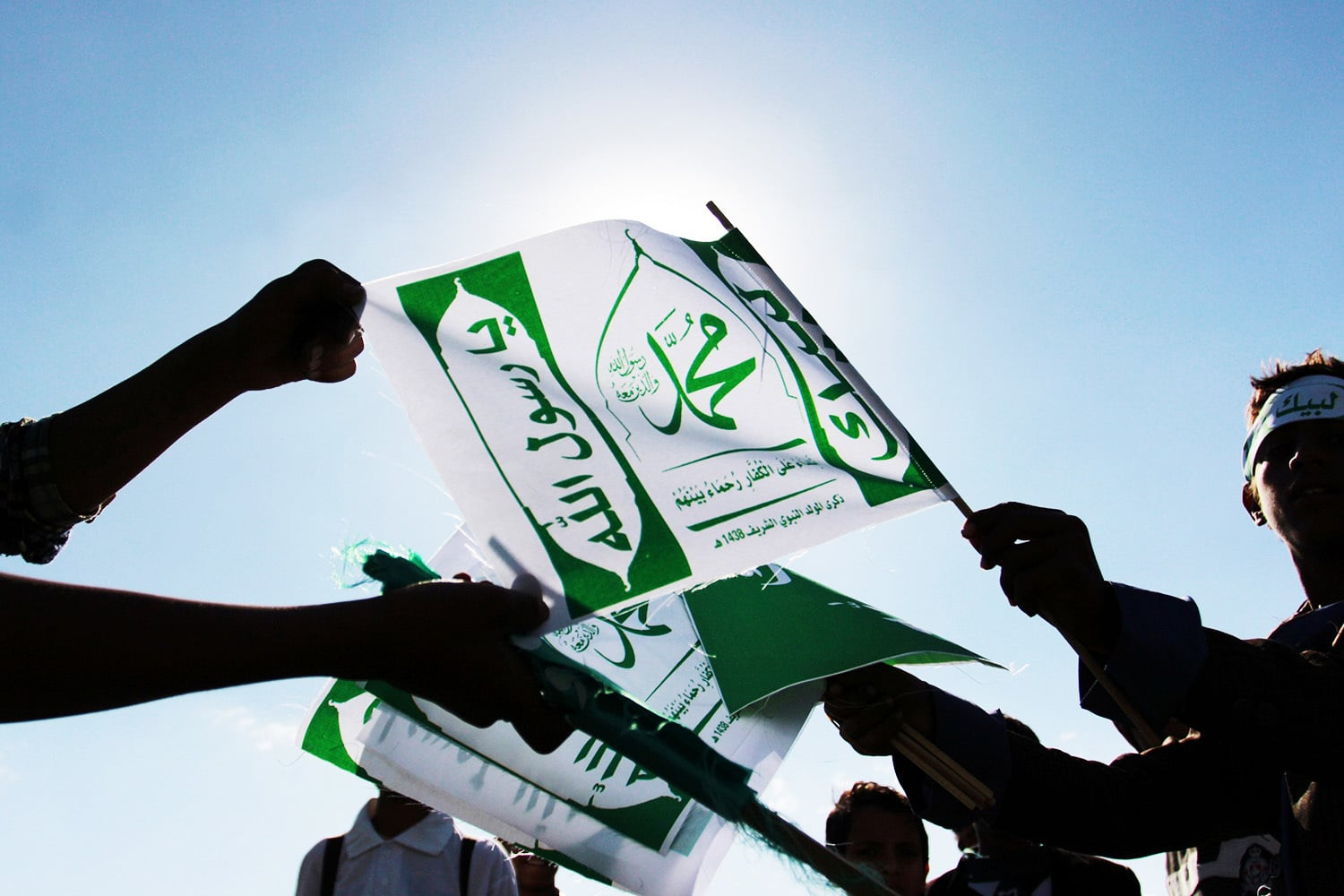 Muslim Yemenis carry placards during a gathering marking the birth anniversary of Prophet Muhammad (PBUH).—AFP