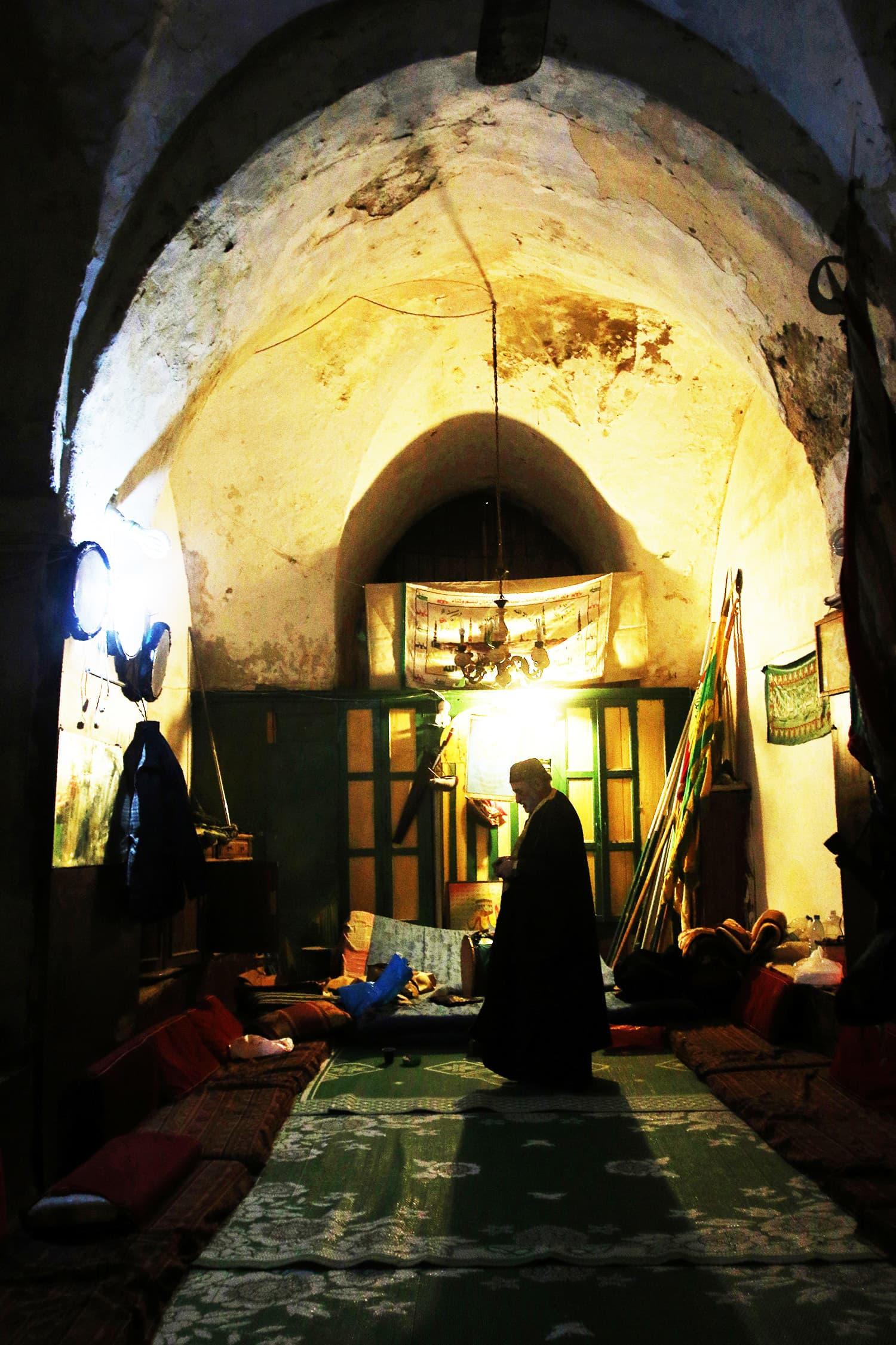A Lebanese Muslim Sufi man prays during a ritual ceremony.—AFP