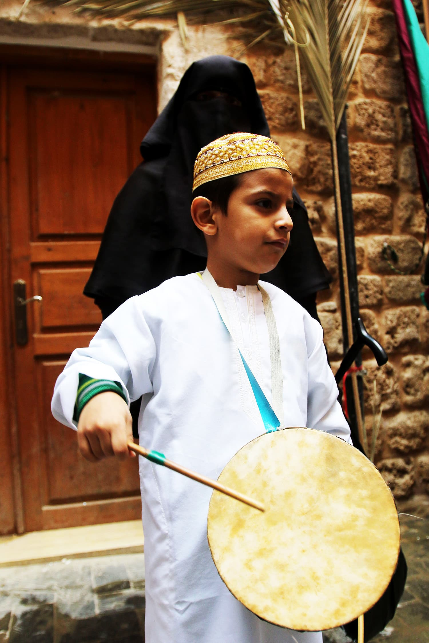 A Lebanese Muslim Sufi child plays music during a ritual ceremony.—AFP