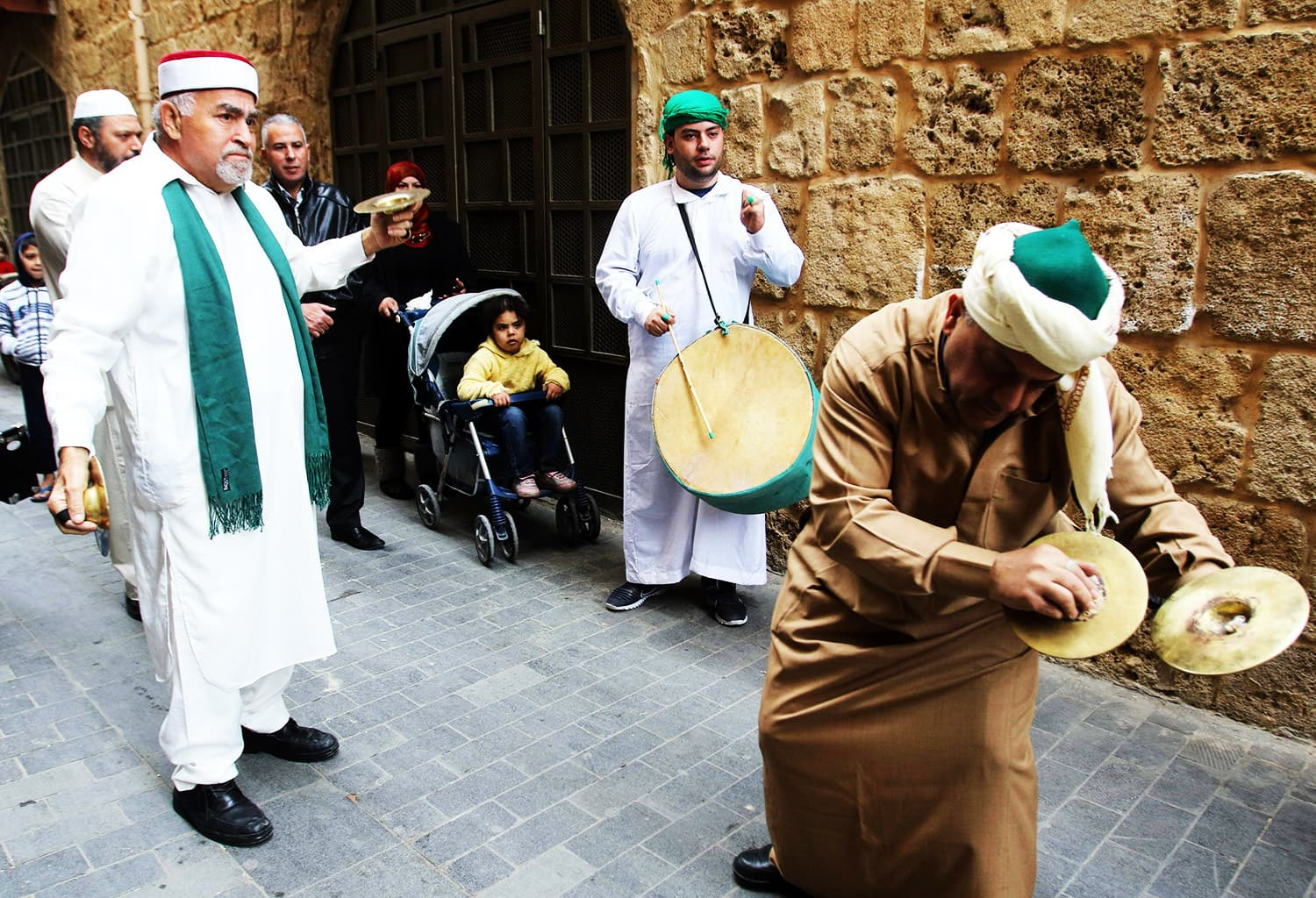 Lebanese Muslim Sufi men play music during a ritual ceremony to commemorate the birth of Holy Prophet (PBUH).— AFP