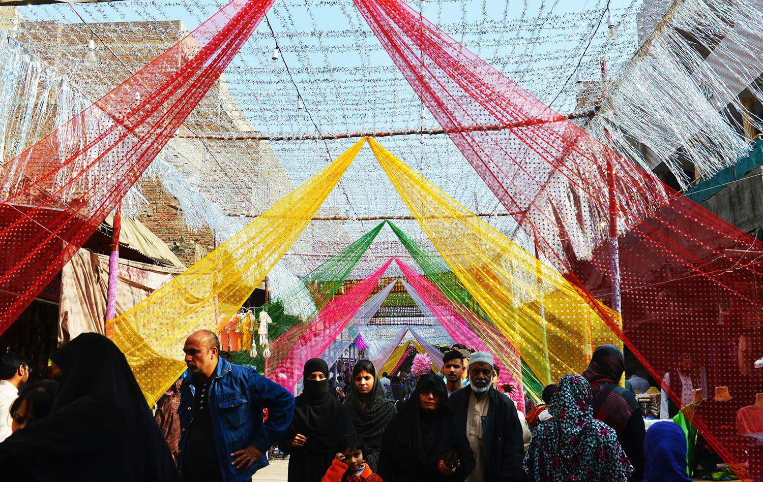 People walk through a decorated market on the celebration of Eid Milad-un-Nabi.—AFP
