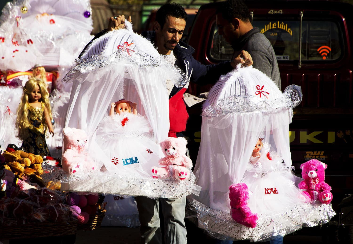 An Egyptian man buys a pair of dolls to celebrate the anniversary of the birthday of Prophet Muhammad (PBUH).—AP
