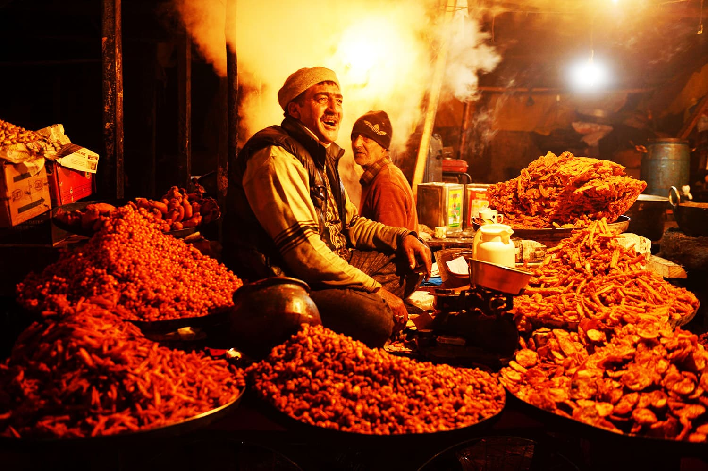 A Kashmiri vendor sells  traditional  Kashmiri snacks on the eve of Eid-e-Milad-un-Nabi in Srinagar.—AFP