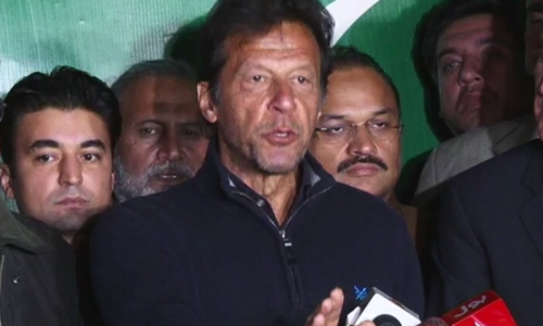 Imran Khan talks to reporters on Tuesday.— DawnNews