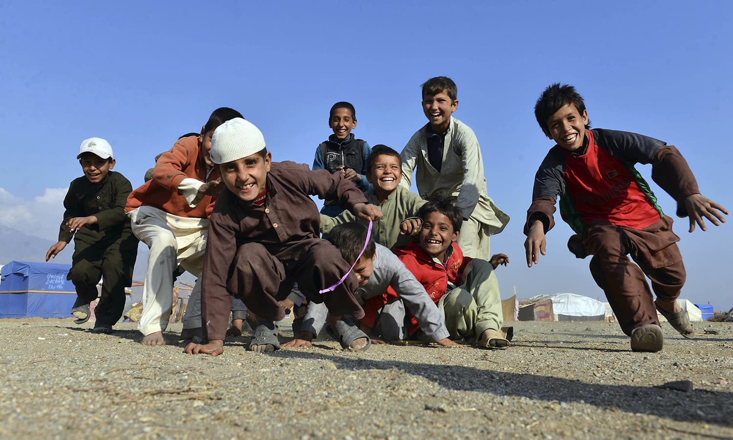 Afghan children play on the outskirts of Jalalabad. — AP