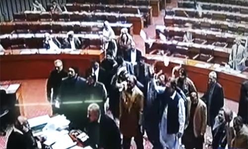 Angry MNAs throw sheets of paper in the air in protest. ─ DawnNews