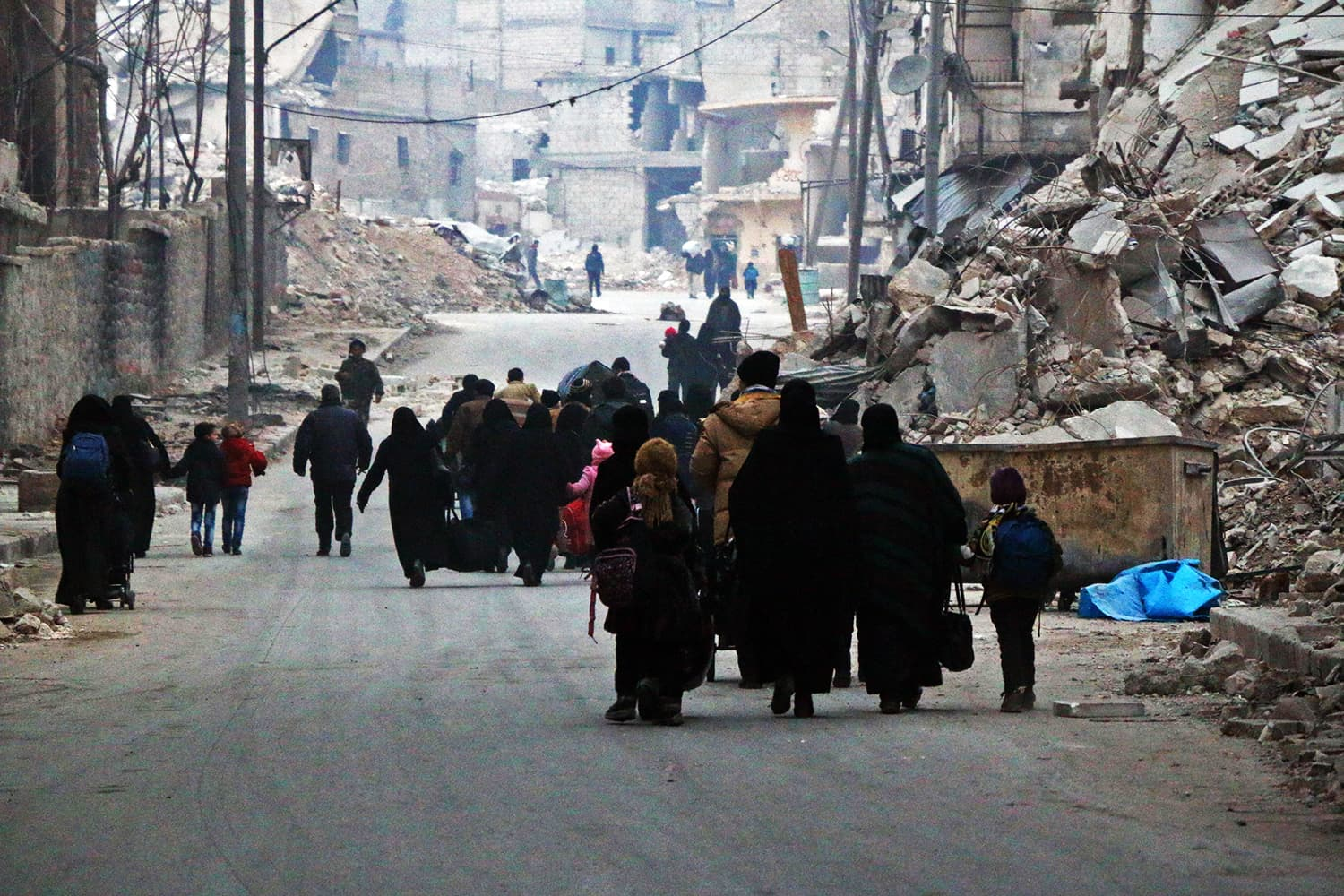 Syrian civilians flee the Sukkari neighbourhood towards safer rebel-held areas in southeastern Aleppo, on December 12, 2016, during an operation by Syrian government forces to retake the embattled city. ─ AFP