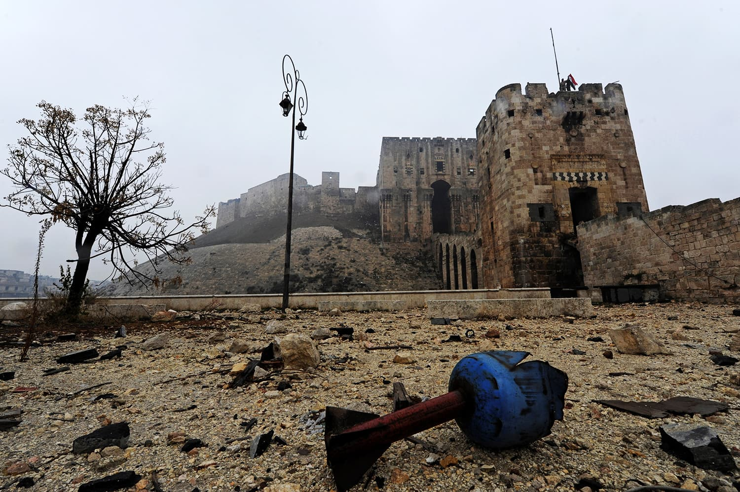 The remains of a shell are pictured outside Aleppo's historic citadel, during a media tour, Syria December 13, 2016. ─ Reuters