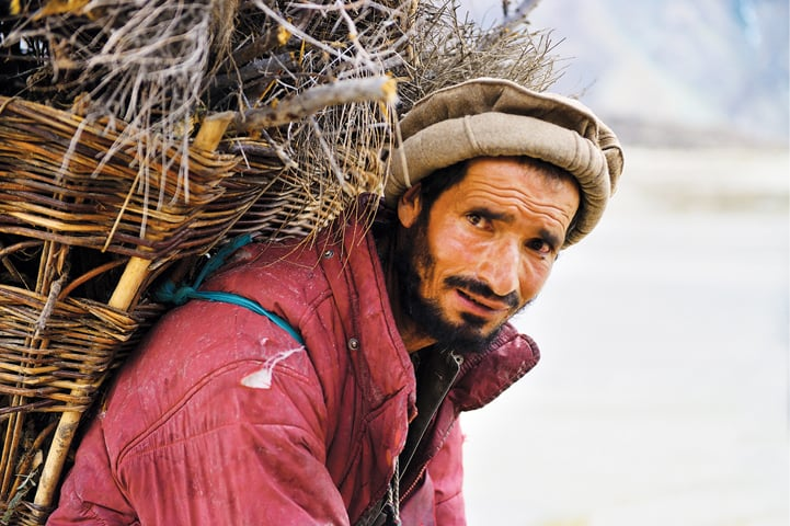 A Balti man after collecting fire wood on the outskirts of Skardu