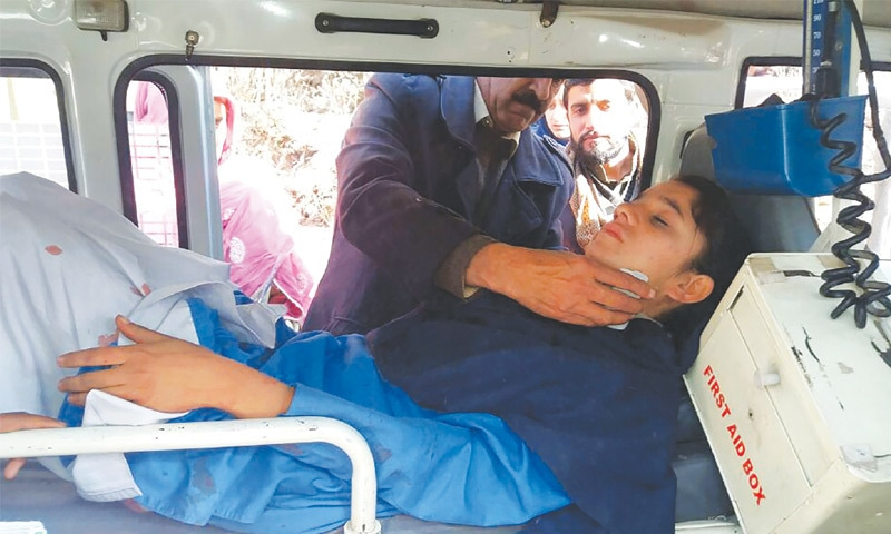 volunteers transport an injured school student to hospital after firing by Indian forces in the village of Mohra in Nakyal sector of Azad Jammu and Kashmir on Friday.—AFP